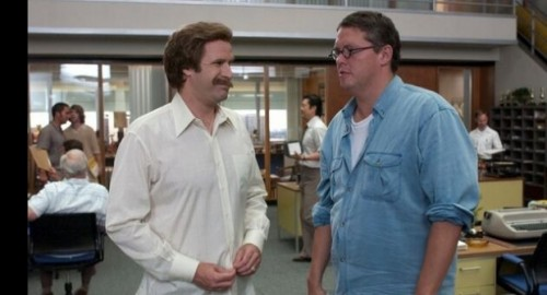 Adam McKay, CLA '90, (right) talks with Will Ferrell on the set of the first Anchorman film.